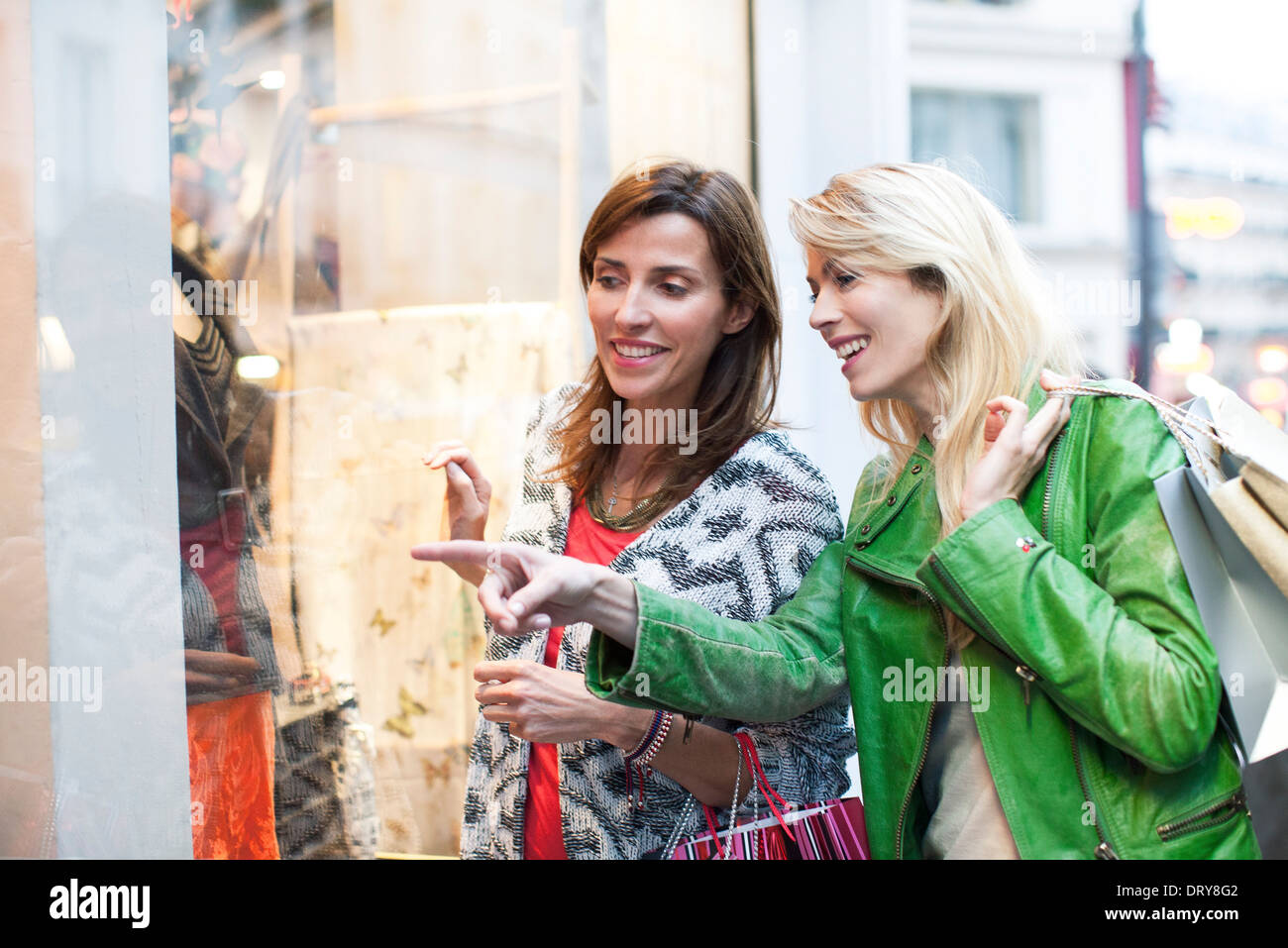 Women window shopping together - Stock Image
