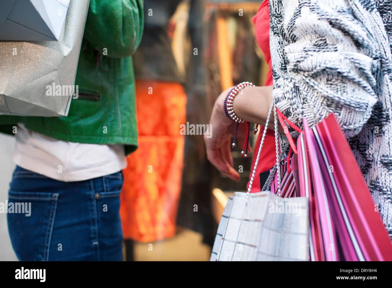 Women with shopping bags window shopping Stock Photo