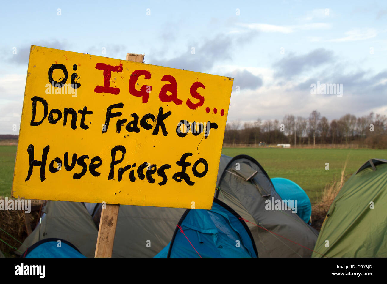 Manchester, Barton Moss, UK. 4th February, 2014.  IGAS Don't frack our House prices £0'  Protests at IGAS Drilling exploration Site, Greater Manchester Policing operation at Barton Moss Drilling Site as Cuadrilla, as one of the energy firms hoping to exploit the UK's shale gas resources, announces two new exploration sites in Lancashire. ... to drill and frack at two sites at Roseacre Wood and Little Plumpton. - Stock Image