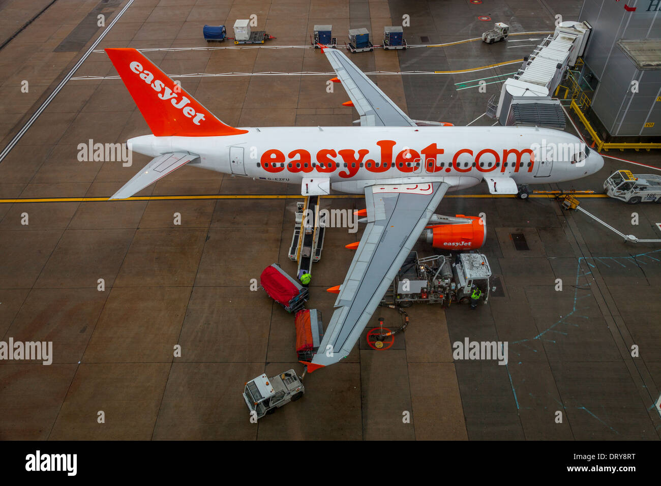 An Easy Jet Airplane At The Gate, North Terminal, Gatwick Airport, Great Britain - Stock Image
