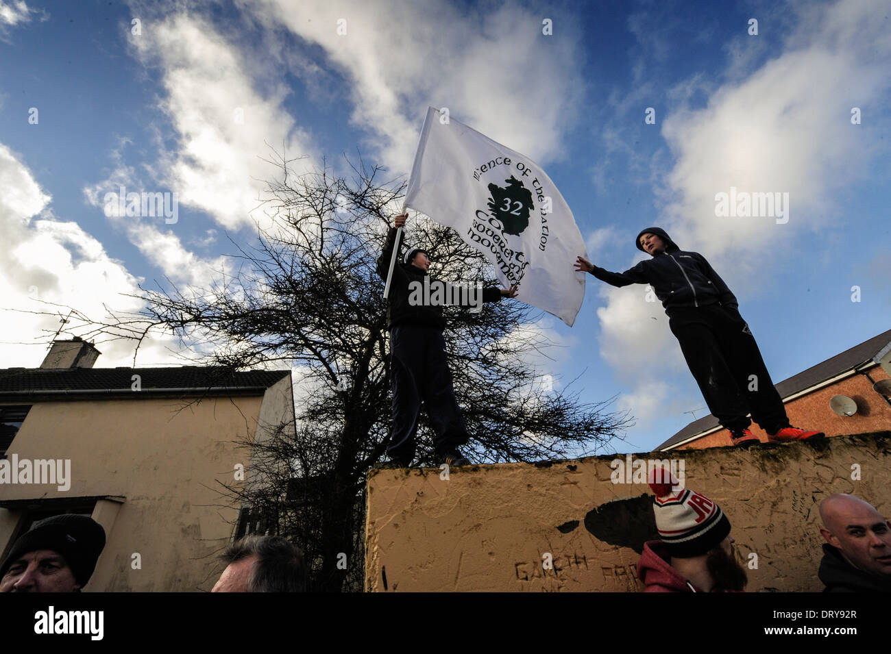 Youths with flag, supporting the dissident republican 32 County Sovereignty Movement at the 42nd anniversary Bloody Sunday march - Stock Image