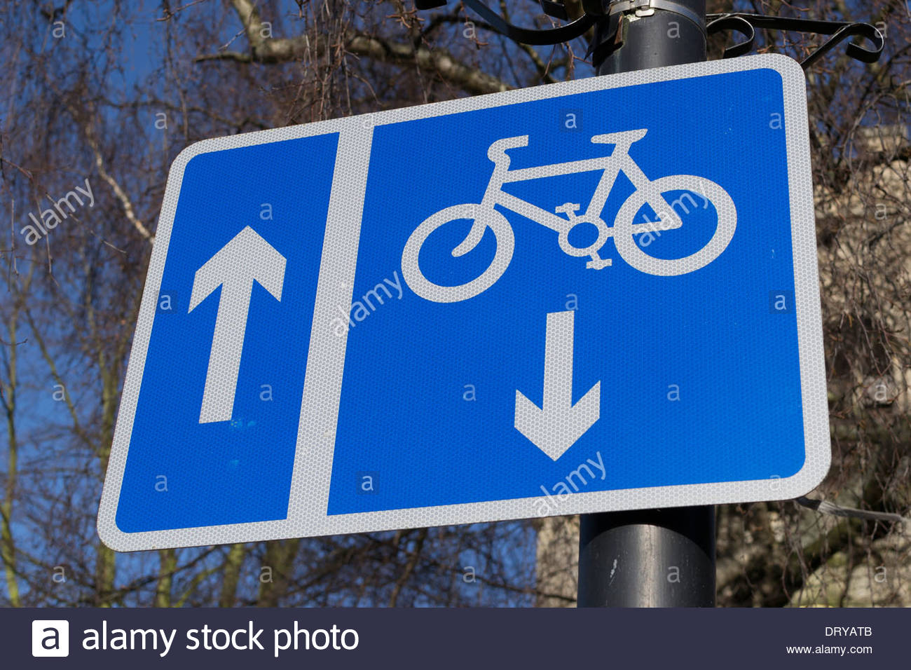 Combined one way vehicle sign with opposing cycle lane - Stock Image
