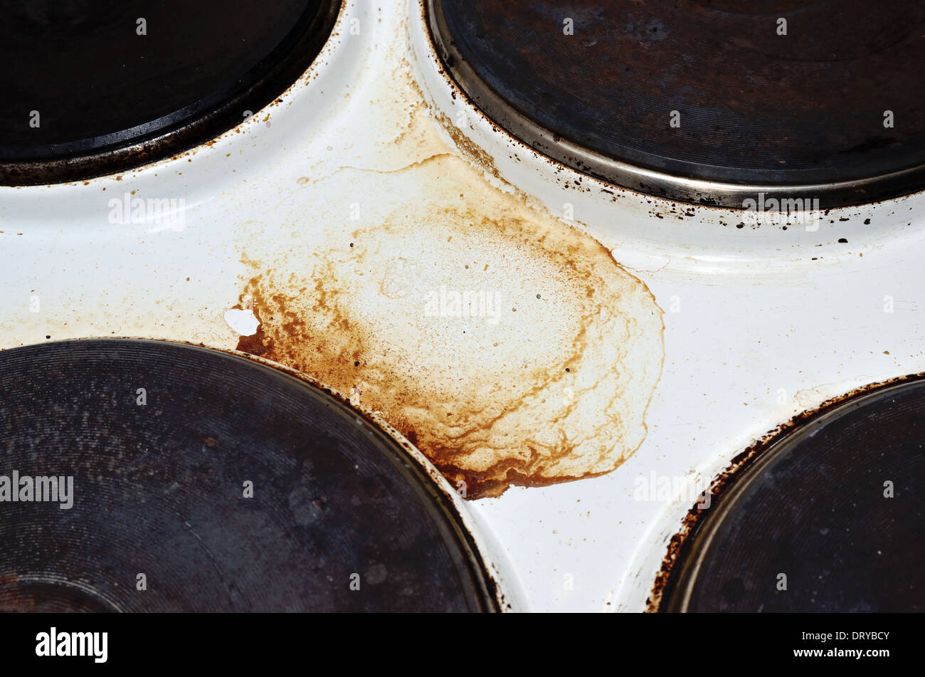 old white enamelled dirty electric cooker, horizontal - Stock Image