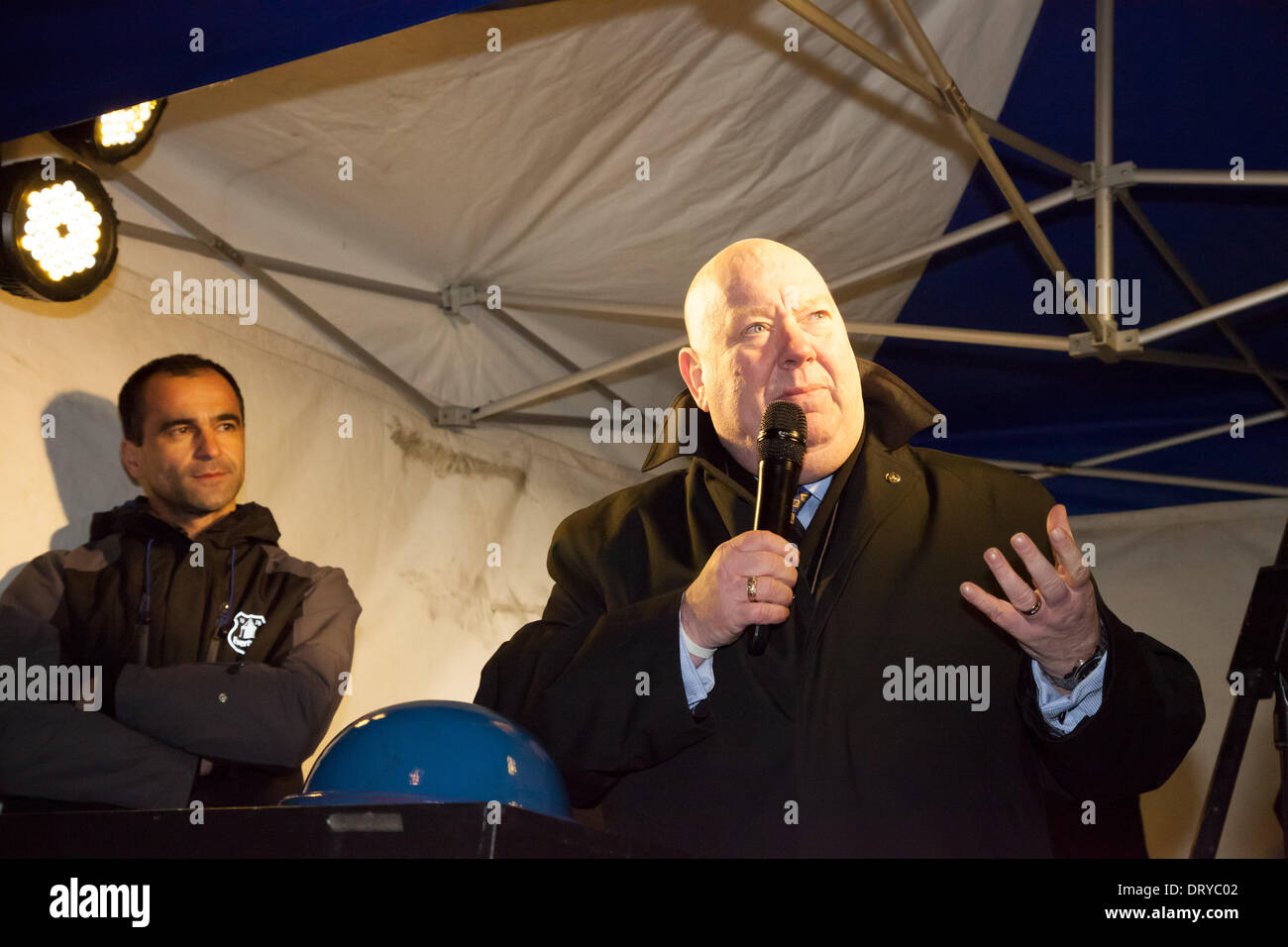 Liverpool, UK. 4th February 2014. Everton manager Roberto Martinez looks on as Liverpool Mayor Joe Anderson delivers a speech. They were both in the Everton district of Liverpool to switch on an illuminated Everton crest. Credit:  Adam Vaughan/Alamy Live News - Stock Image