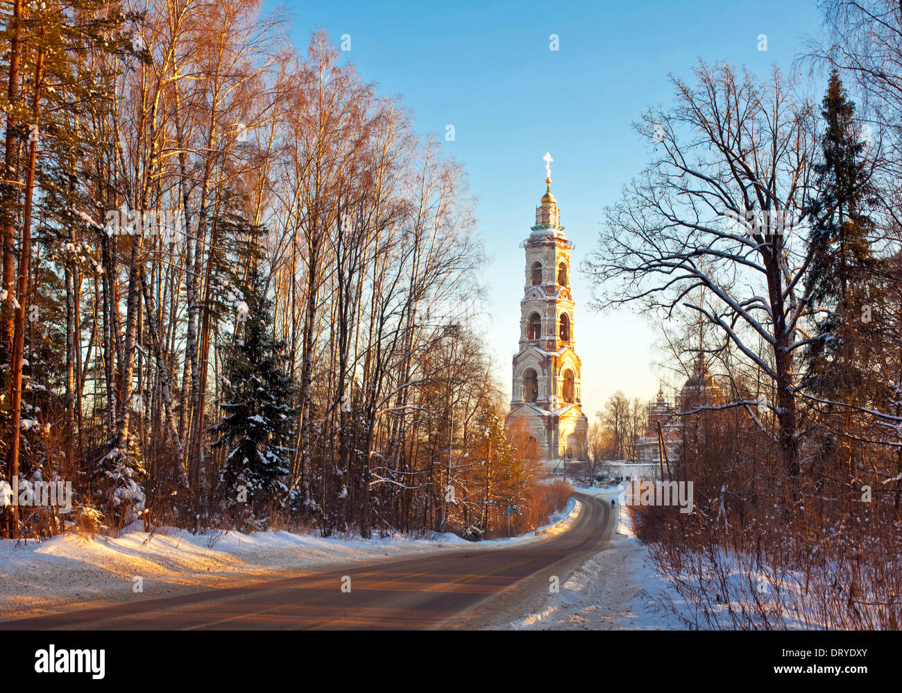 Beautiful winter sunset in the forest and church Stock Photo