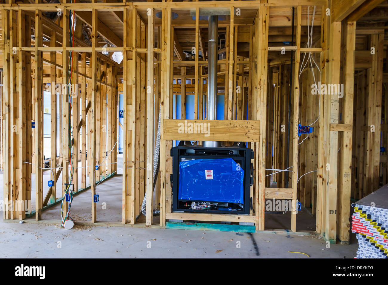 Unfinished interior framing of new custom home under construction ...