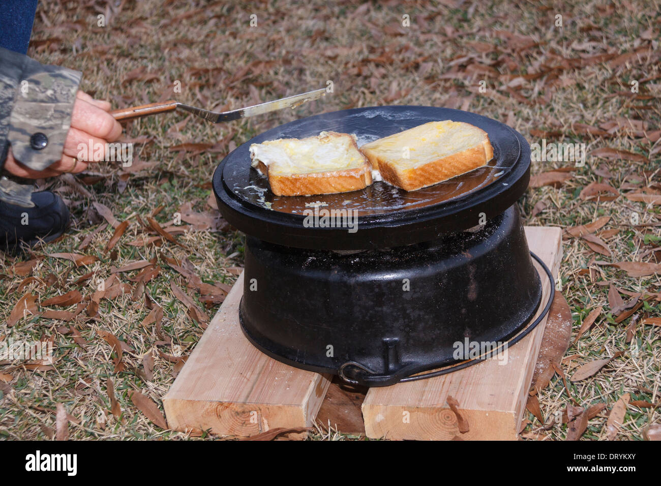 Cooking French Toast On Upside Down Lid Of Dutch Oven Cast Iron