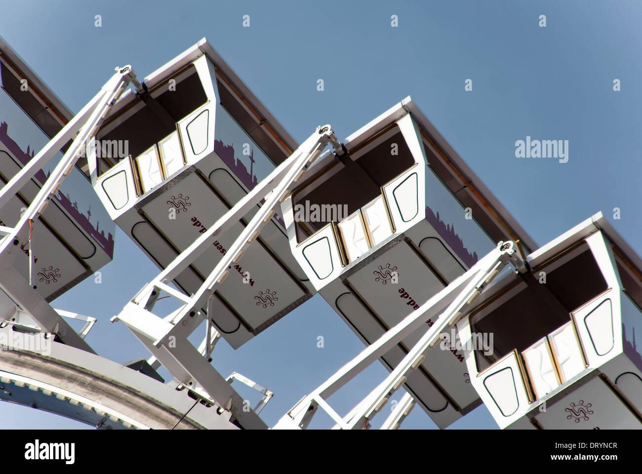 Ferris wheel gondolas in the harbor city Stock Photo