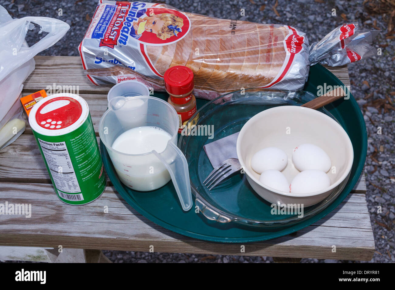 Cooking supplies setup for making French Toast in cast iron Dutch Oven pots Stock Photo