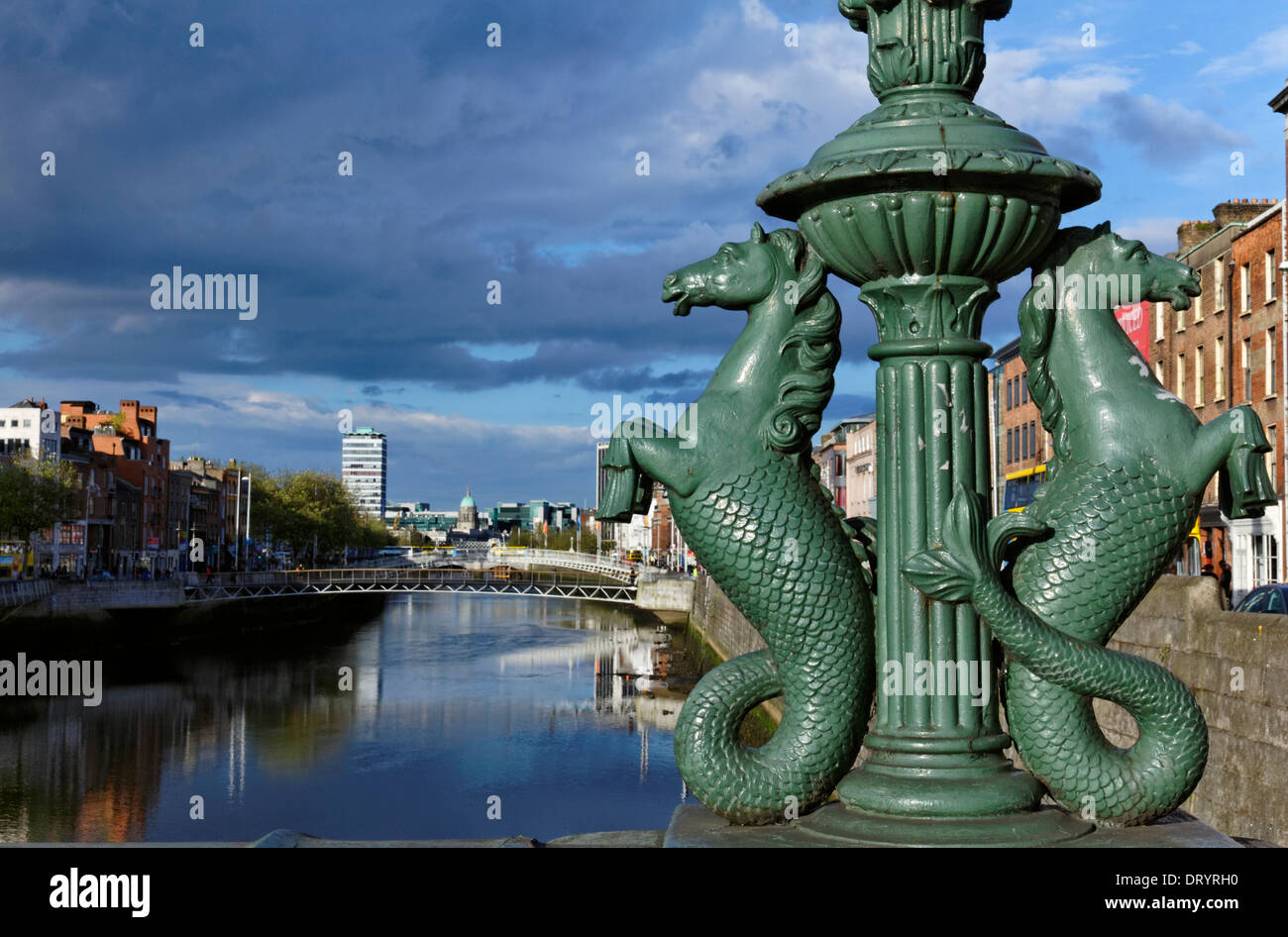 The River Liffey with the Ha'Penny Bridge in the distance, Dublin, Ireland - Stock Image
