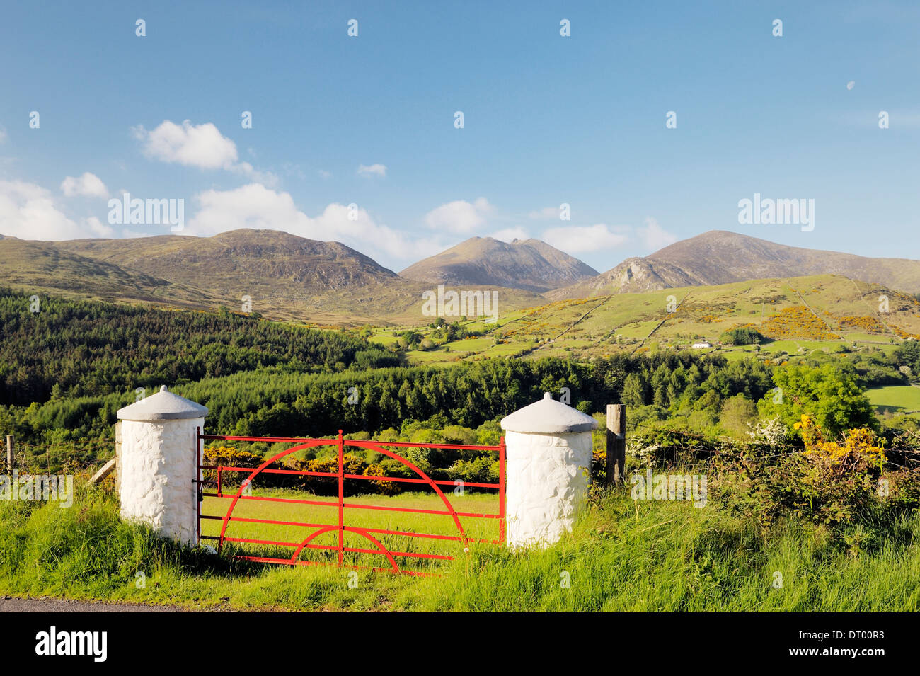 The Mourne Mountains, County Down, Northern Ireland. South over the Trassey Valley and Tollymore Forest Park to Slieve Bearnagh Stock Photo