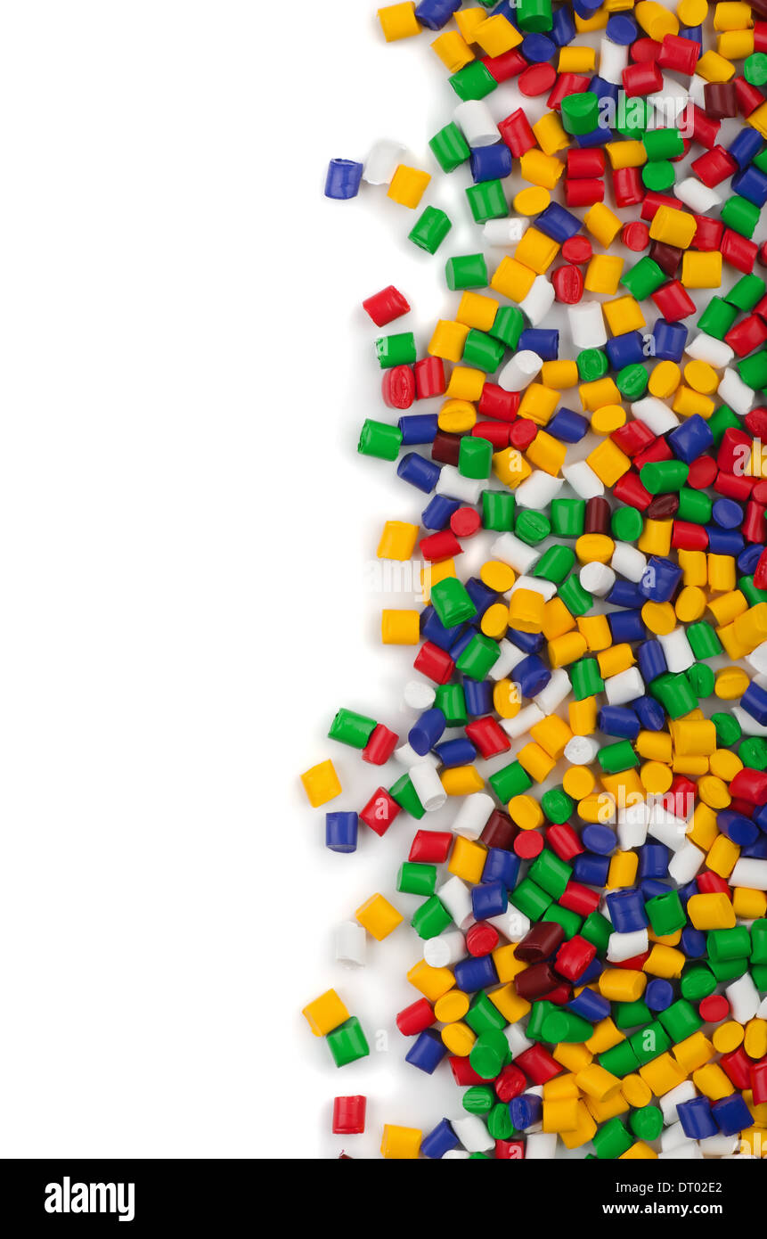 Colorful plastic polymer granules on white background Stock Photo
