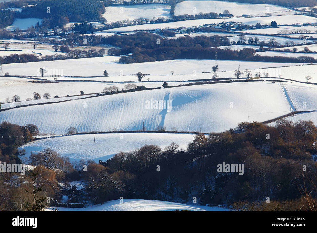 Rolling, snow-covered farmland, seen from Mamhead in the Haldon Hills, near Exeter, south Devon, Great Britain. - Stock Image