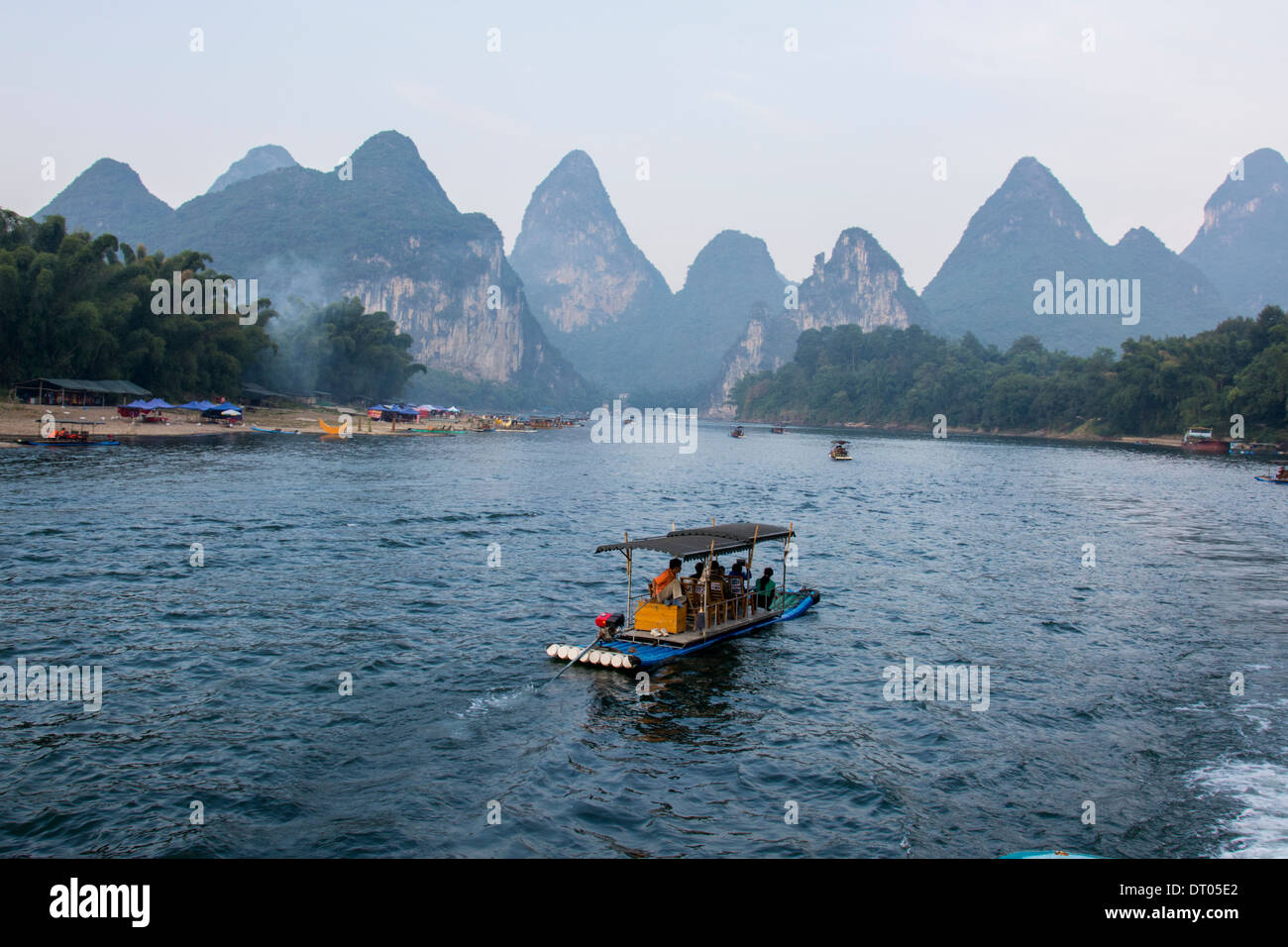 China, Yangshuo County, Bamboo rafts on the Yulong River Karst formations Stock Photo