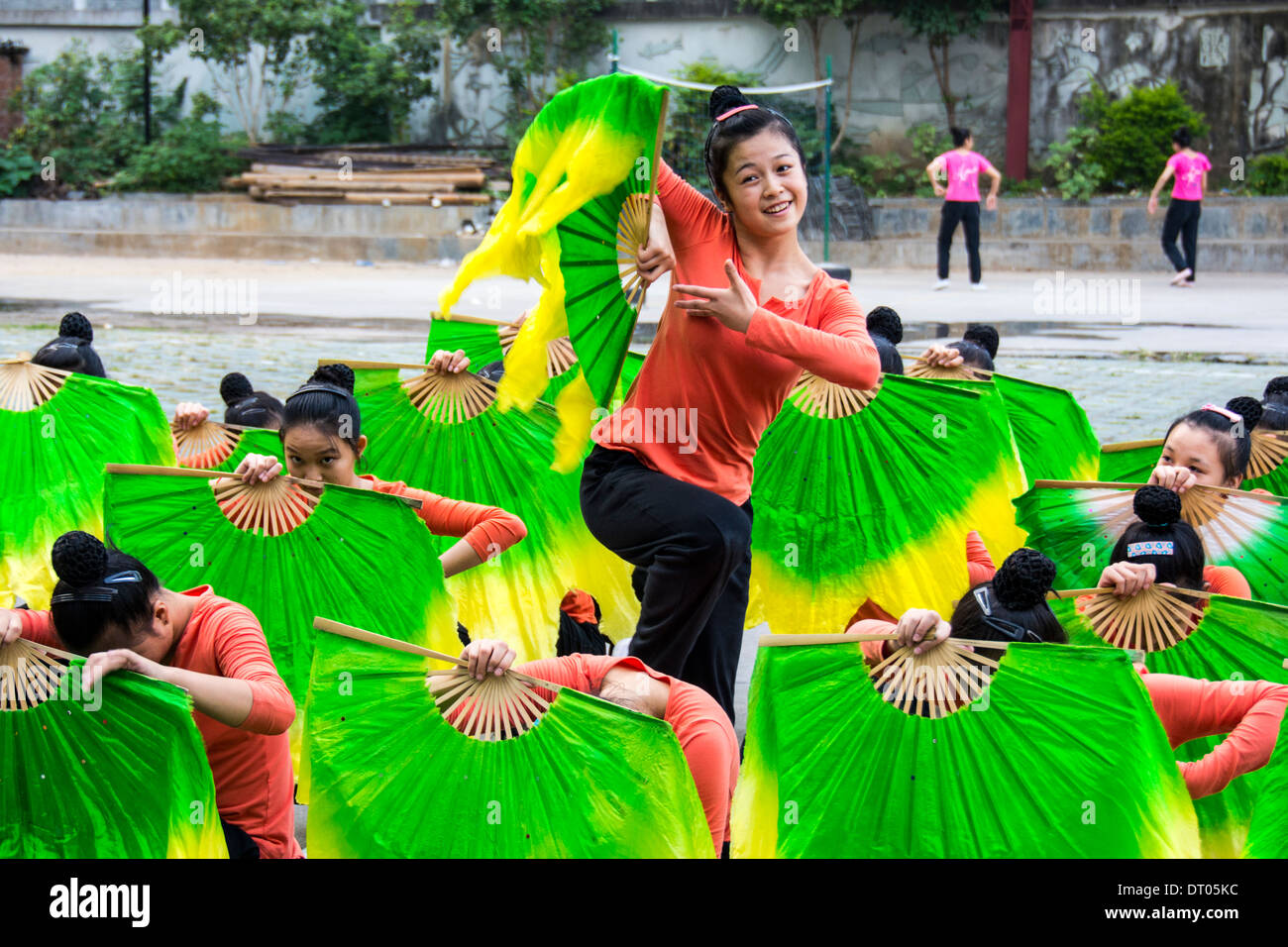 China, Guilin, schoolgirls dance during a sports lesson - Stock Image