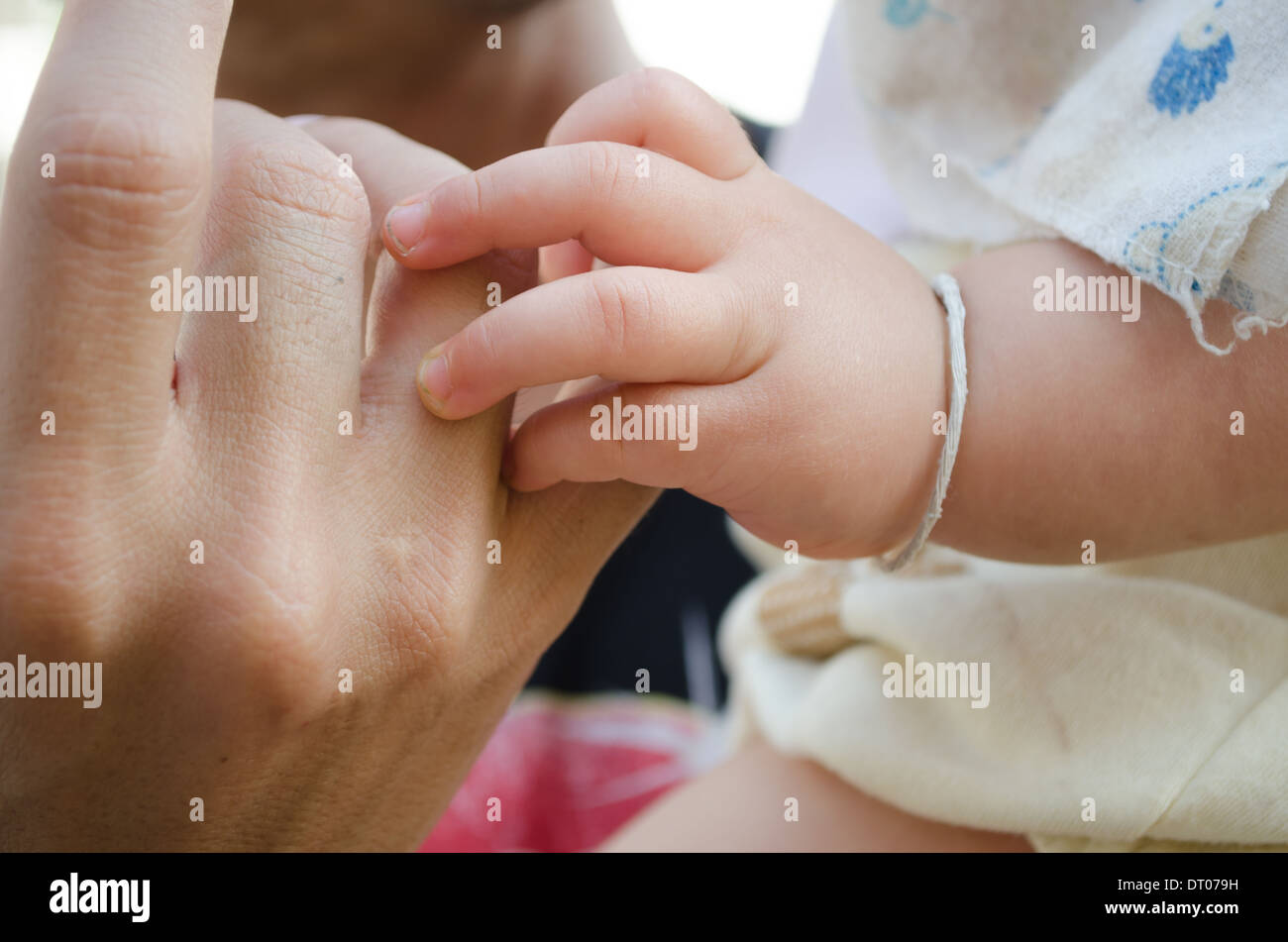 baby finger with relation - Stock Image