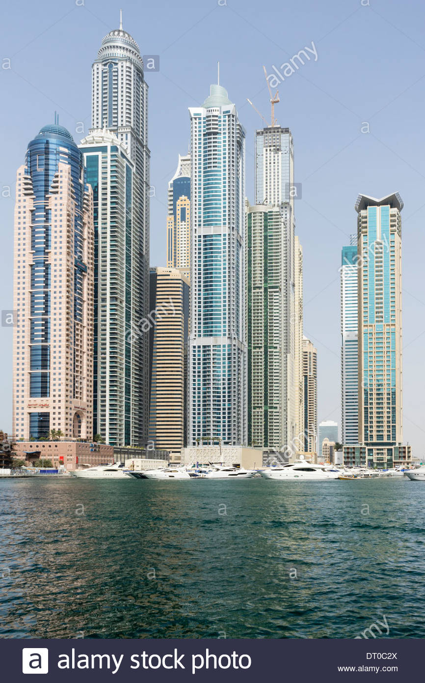 Very tall high-rise apartment towers in Marina district in new Dubai in United Arab Emirates - Stock Image