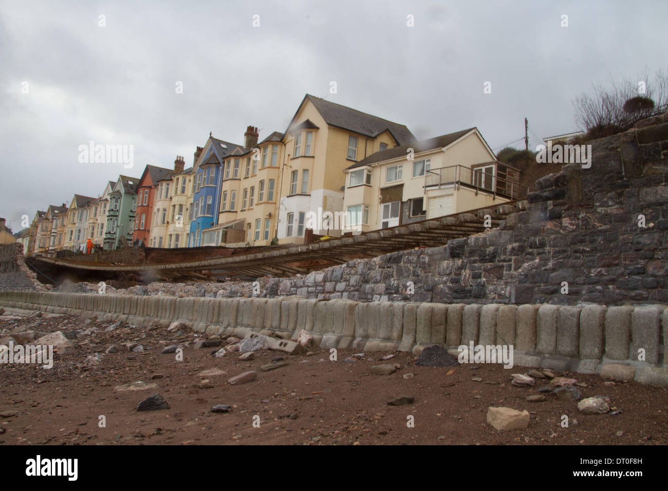 Dawlish, Devon, UK. 5th February 2014. Workers inspect the damaged line at Dawlish. High tide waves smashed the sea wall and badly damaged the track. Credit:  nidpor/Alamy Live News - Stock Image