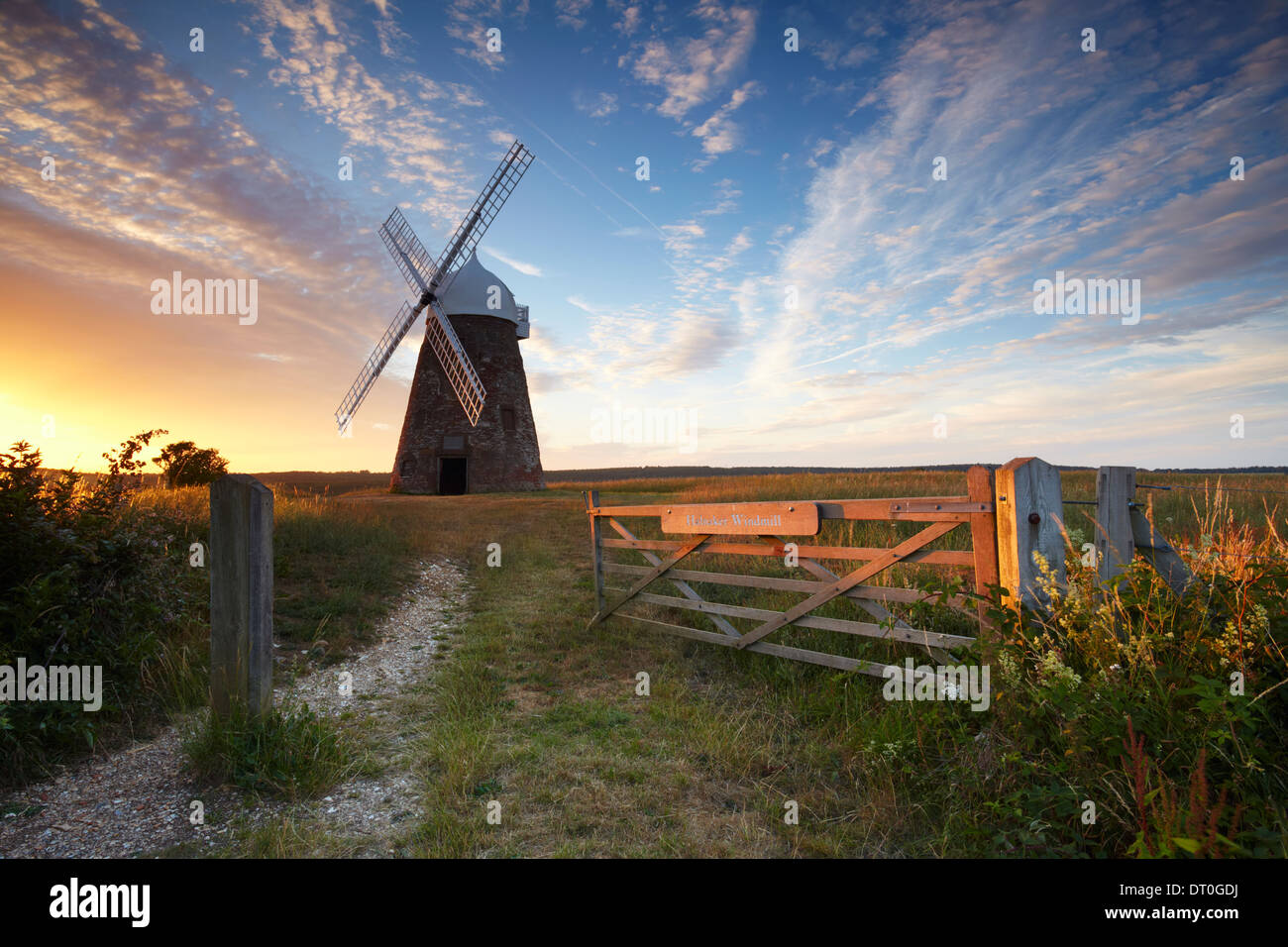 A beautiful summers evening at Halnaker windmill. Located high up on a hilltop on the South Downs National Park - Stock Image