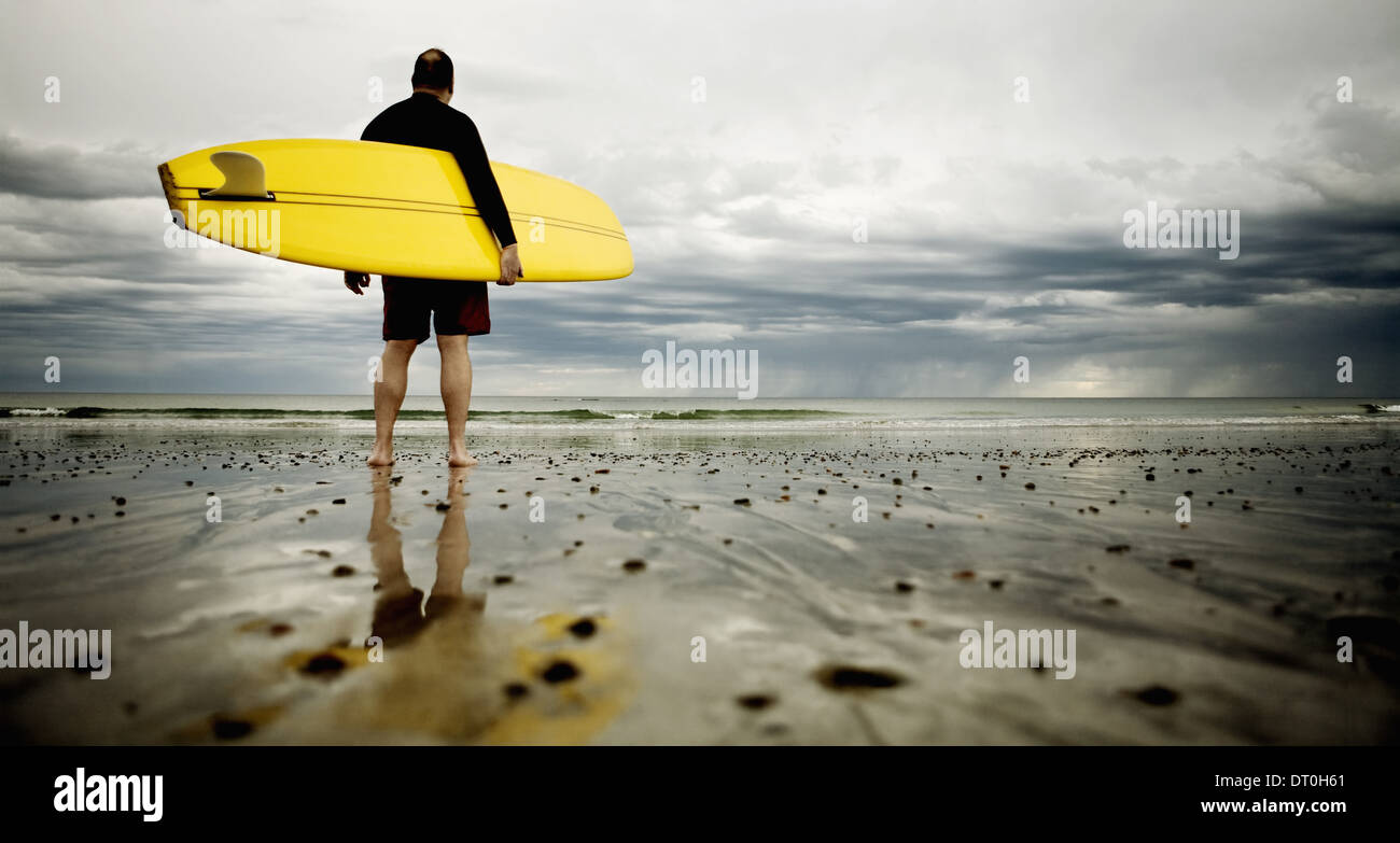 Massachusetts USA middle aged man surfer New England Rockport Beach - Stock Image