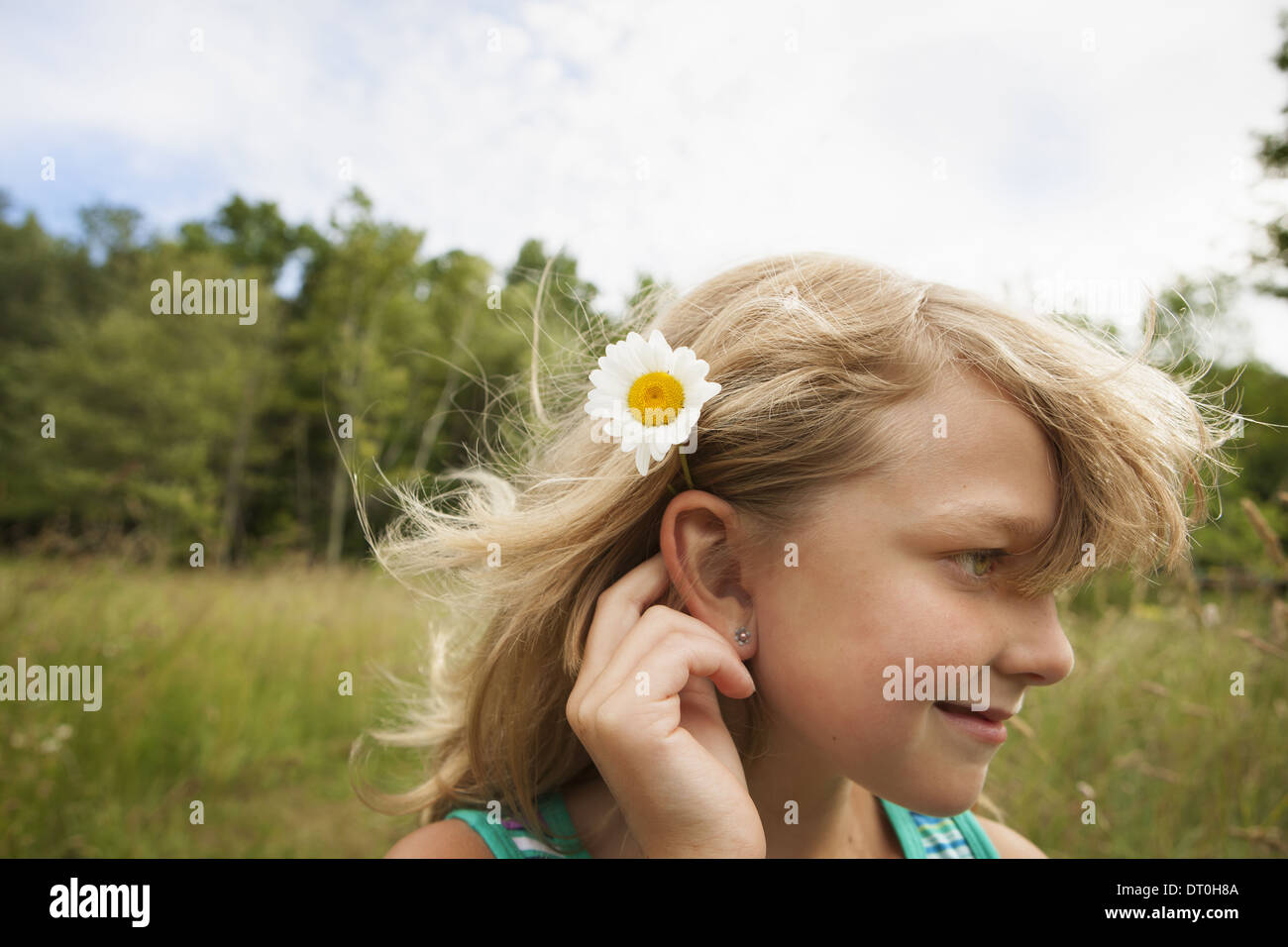 Flower behind ear stock photos flower behind ear stock images alamy new york state usa young girl outside daisy flower behind ear stock image izmirmasajfo
