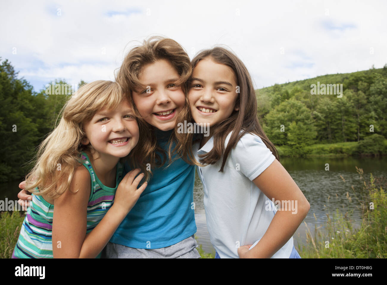New York state USA Three young girls friends posing for photograph - Stock Image