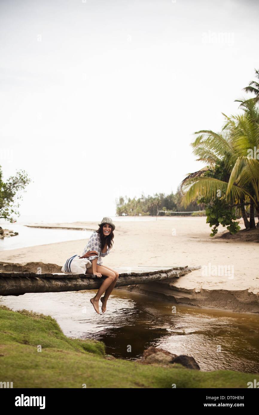 Samana Peninsula Dominican Republic. young woman on wooden bridge over small creek - Stock Image