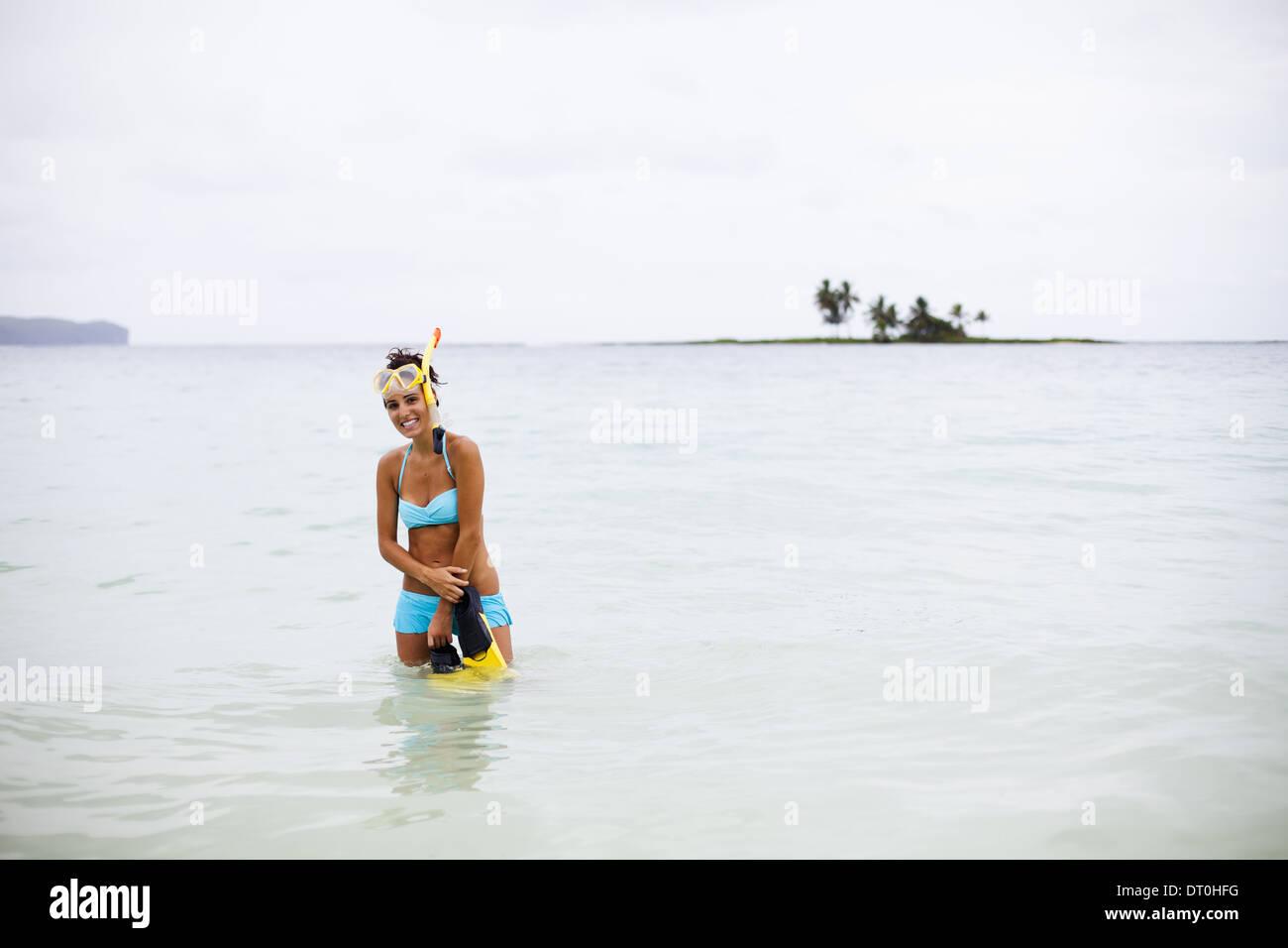Samana Peninsula Dominican Republic. young woman wades in sea water Dominican Republic Stock Photo