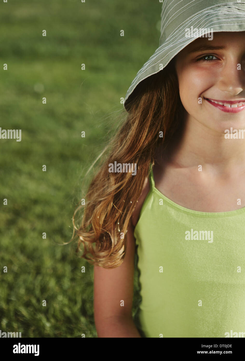 Seattle Washington USA smiling nine year old girl field of grass - Stock Image