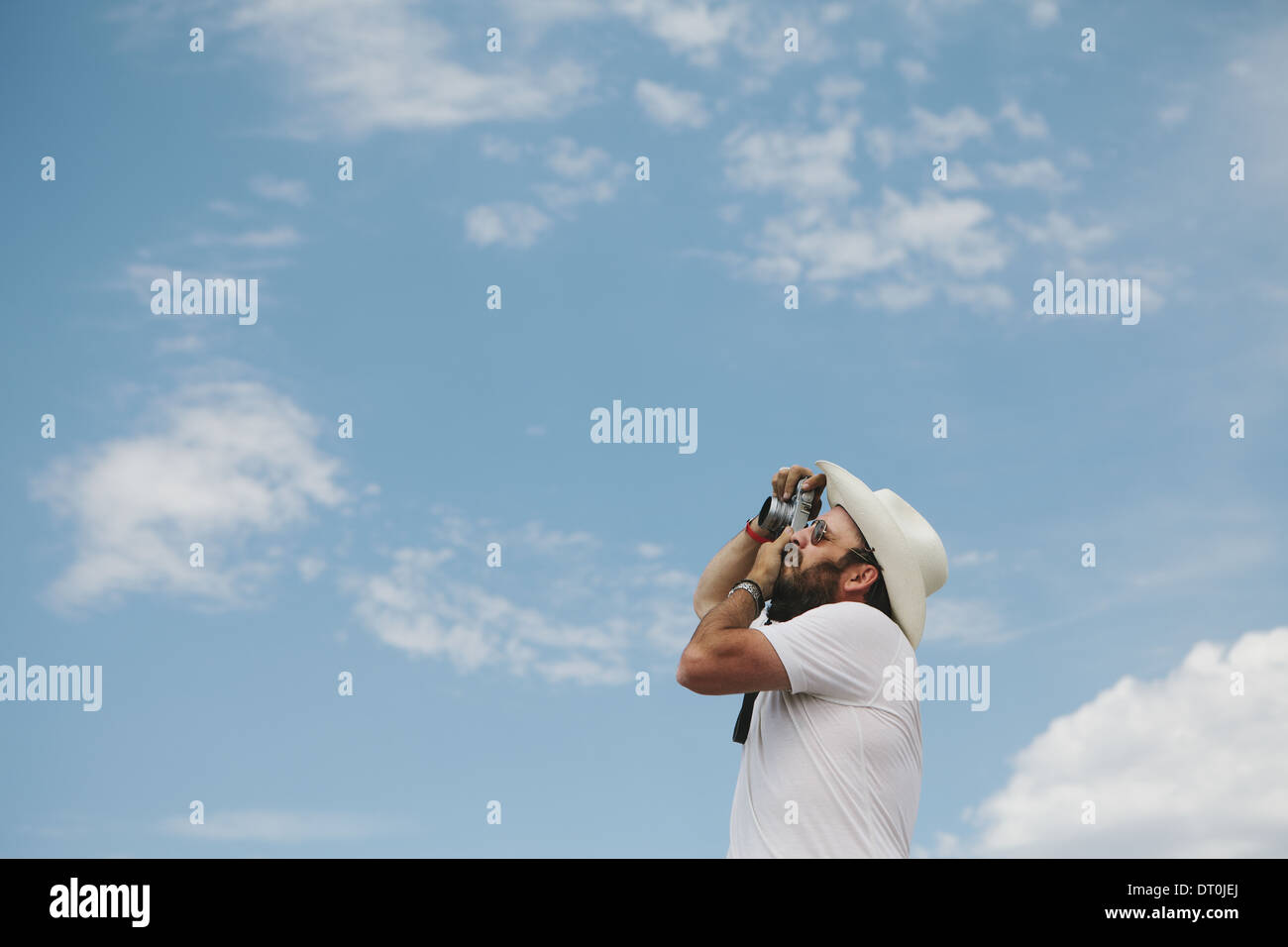 Nevada USA Man taking photograph of clouds and sky - Stock Image