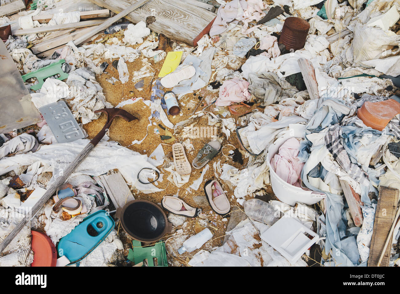 heap of garbage discarded Wooden plants plastic - Stock Image