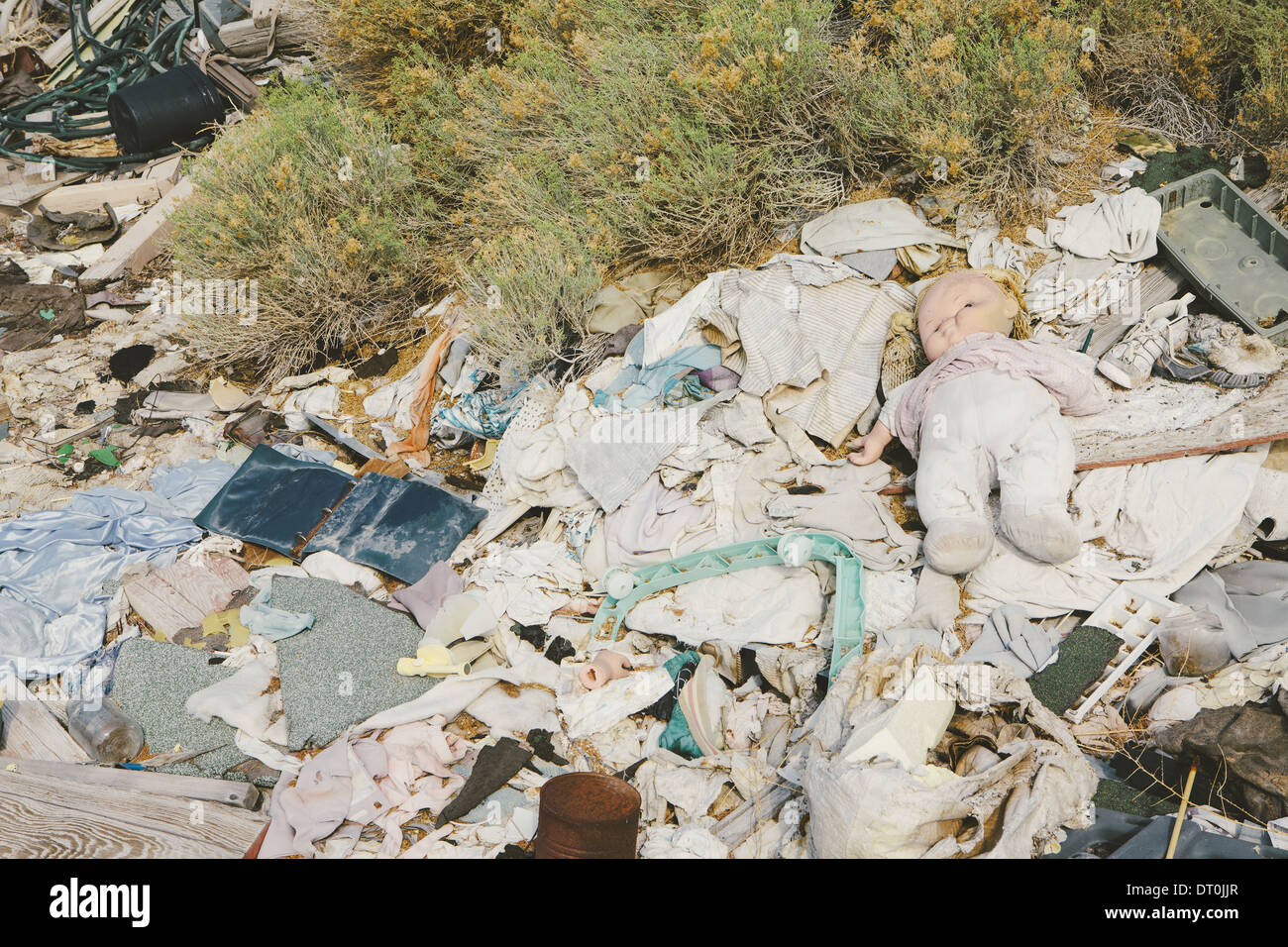 garbage discarded Rubbish paper children's doll - Stock Image