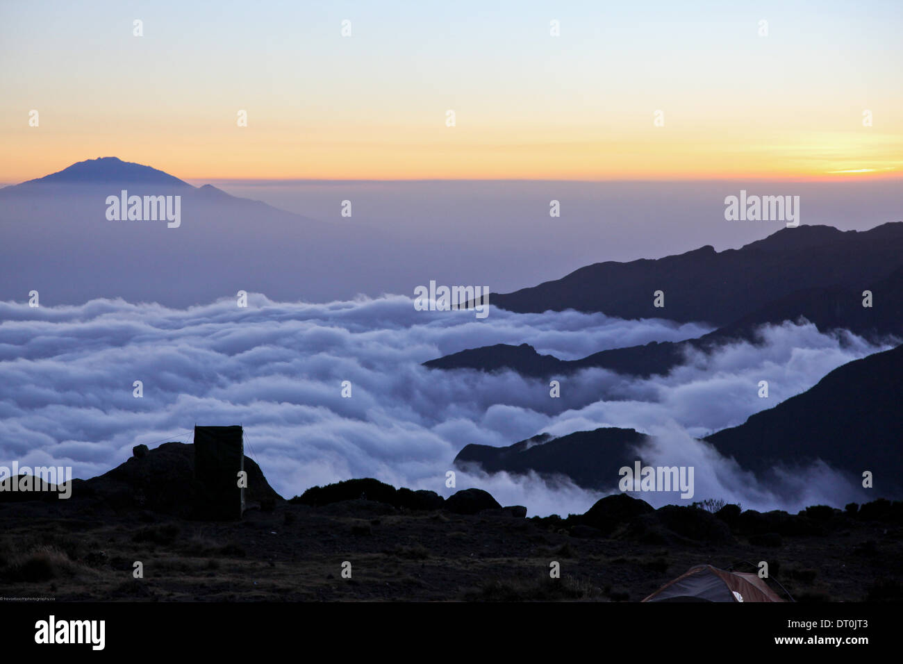 Mount Meru of Arusha National Park in the distance, taken at sunset from Shira camp on Mount Kilimanjaro - Stock Image