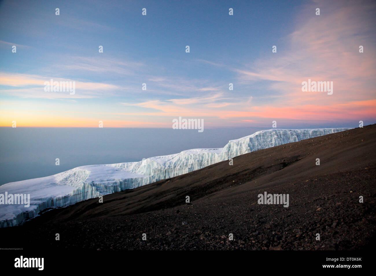 glacier on top of Mount Kilimanjaro at sunrise - Stock Image