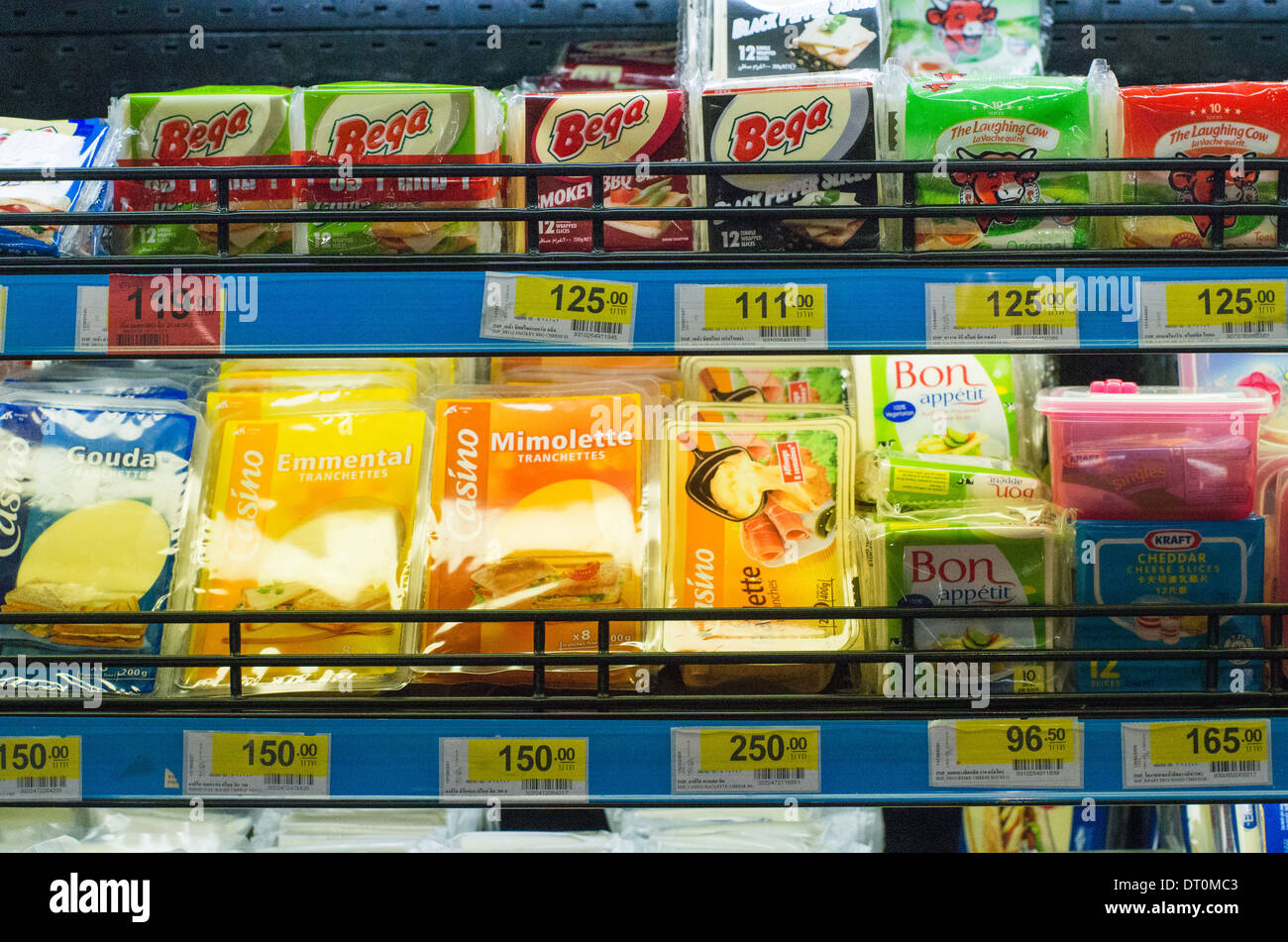 variety of cheese products available on shelf of supermarket