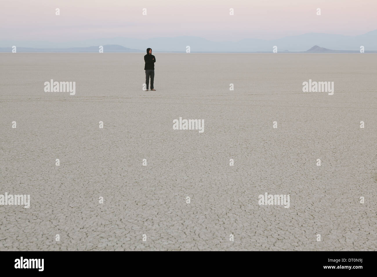 Black Rock Desert Nevada USA Man standing in vast desert landscape Stock Photo