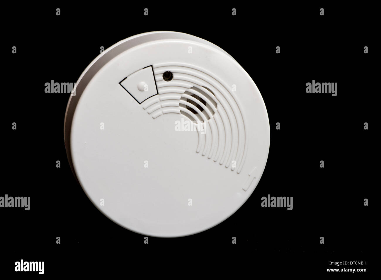 Fire safety with a smoke detector - Stock Image
