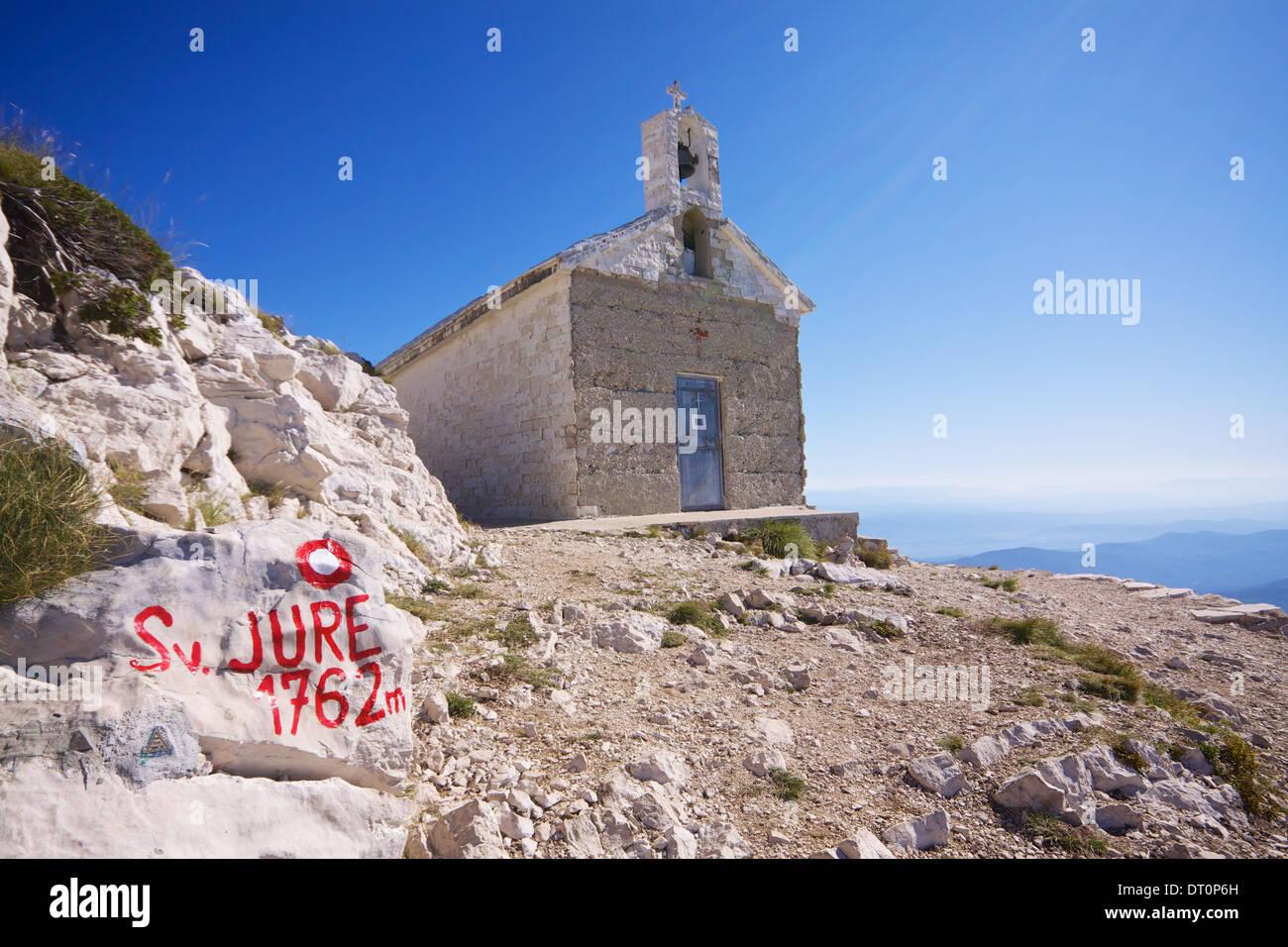 Christian chapel on Sveti Jure, highest mountain of Biokovo nature park on Makarska Riviera in Croatia - Stock Image