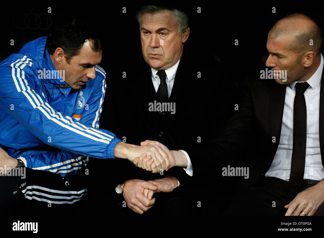 Madrid, Spain. 5th Feb, 2014. Carlo Ancelotti (C) and ZinÌÄ©dine Zidane during the Spanish King's Cup Semifinal, Stock Photo