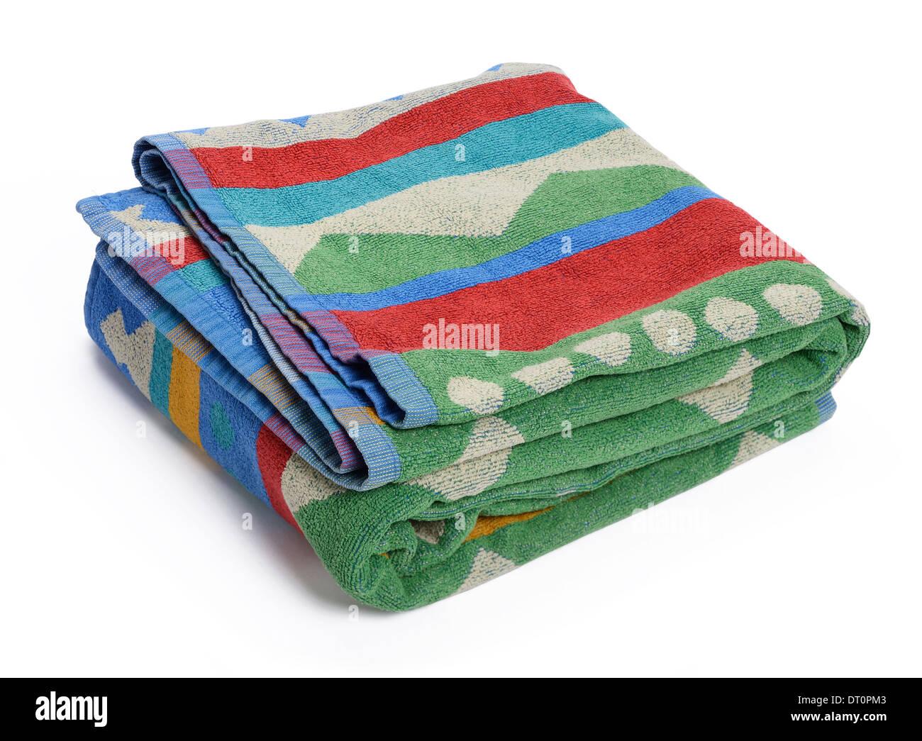 Colourful beach towel - Stock Image