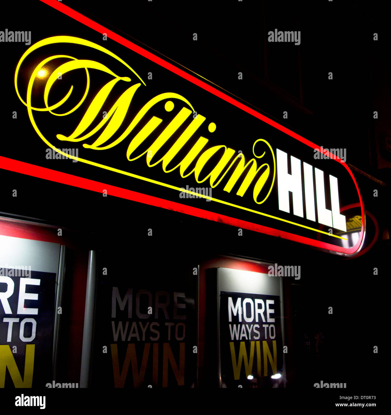 William Hill Betting Shop Sign Illuminated At Night, UK - Stock Image