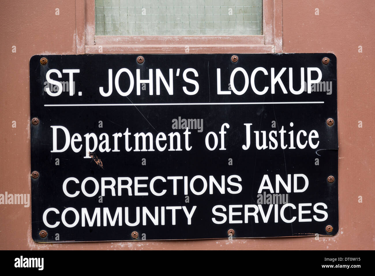 sign on the door of st johns city lockup it is the temporary detention centre for those awaiting appearance before the courts