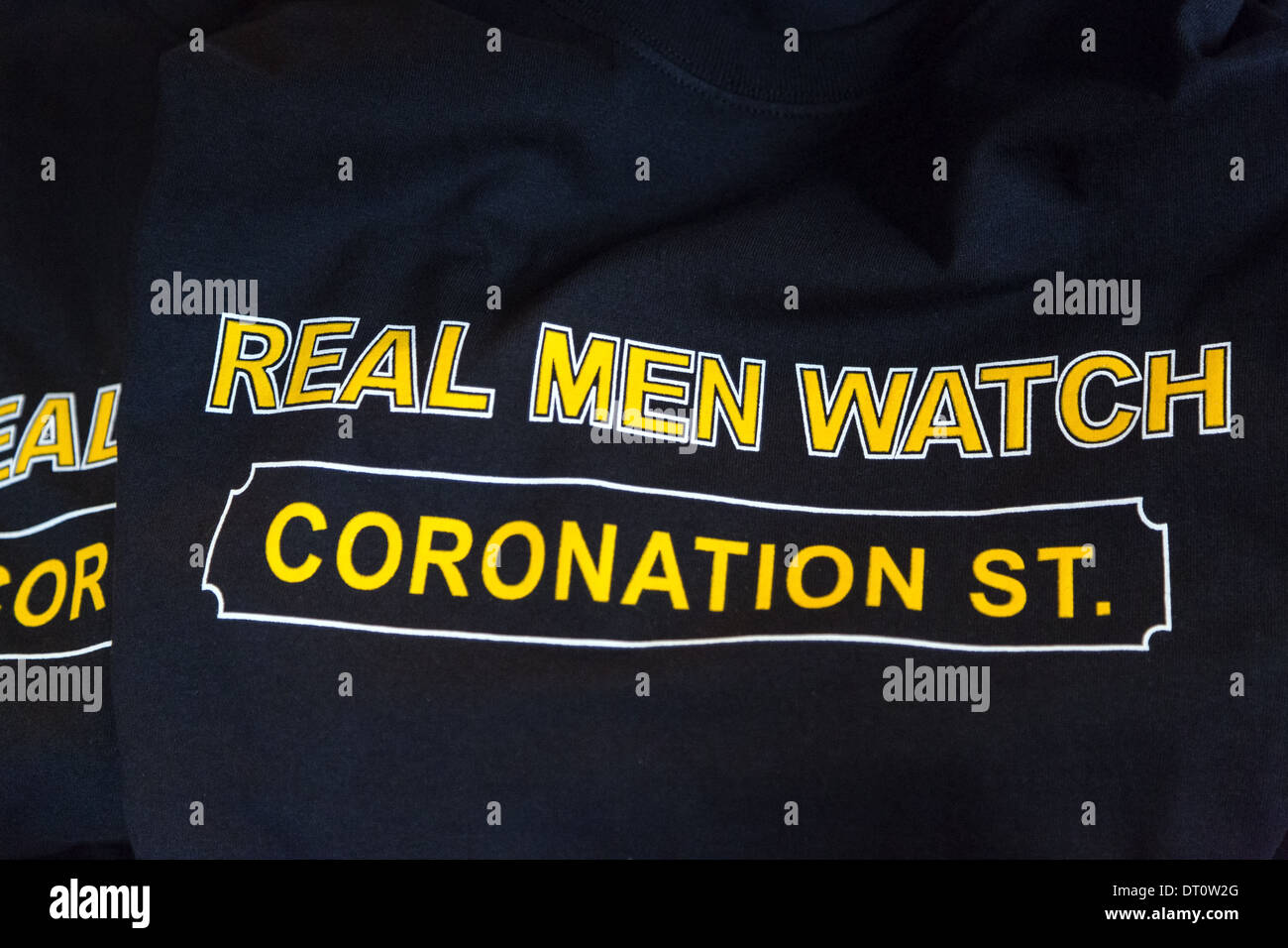Tee-shirts with the words Real Men Watch Coronation Street printed on them - Stock Image