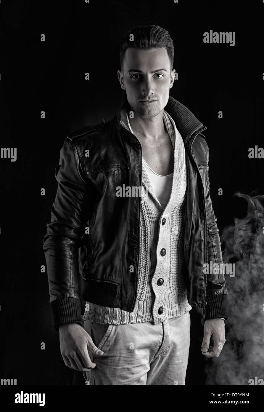 Attractive Young Man With White Sweater And Black Leather Jacket