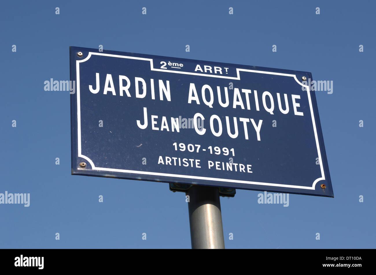 Blue street sign for Jardin aquatique Jean Couty,showing name of Jean Couty, artiste, peintre, La Confluence area, Lyon, France - Stock Image