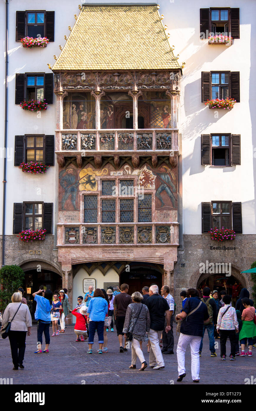 Tourists at Goldenes Dachl, Golden Roof, built 1500 of gilded copper in Herzog Friedrich Strasse, Innsbruck the Tyrol Austria - Stock Image