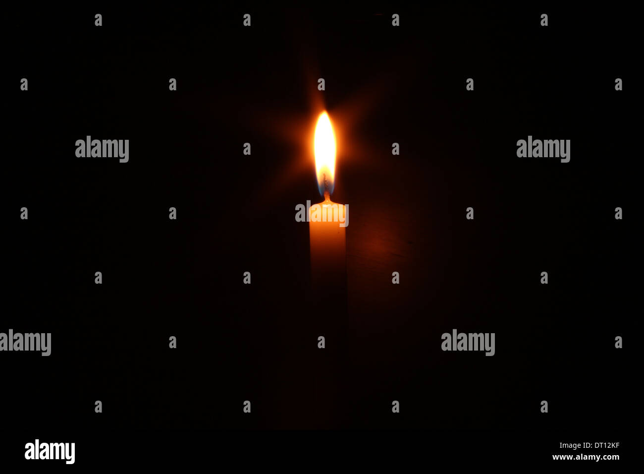 Candle with starburst - Stock Image