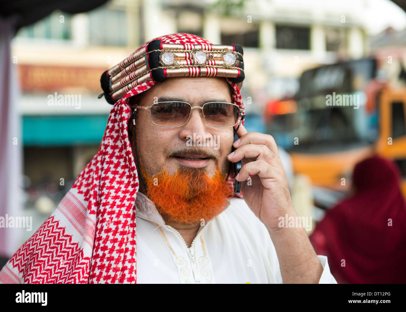 A Handsome Arab Sheik using his mobile phone. - Stock Image