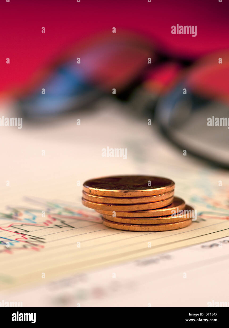 Stack of pennies on chart. - Stock Image