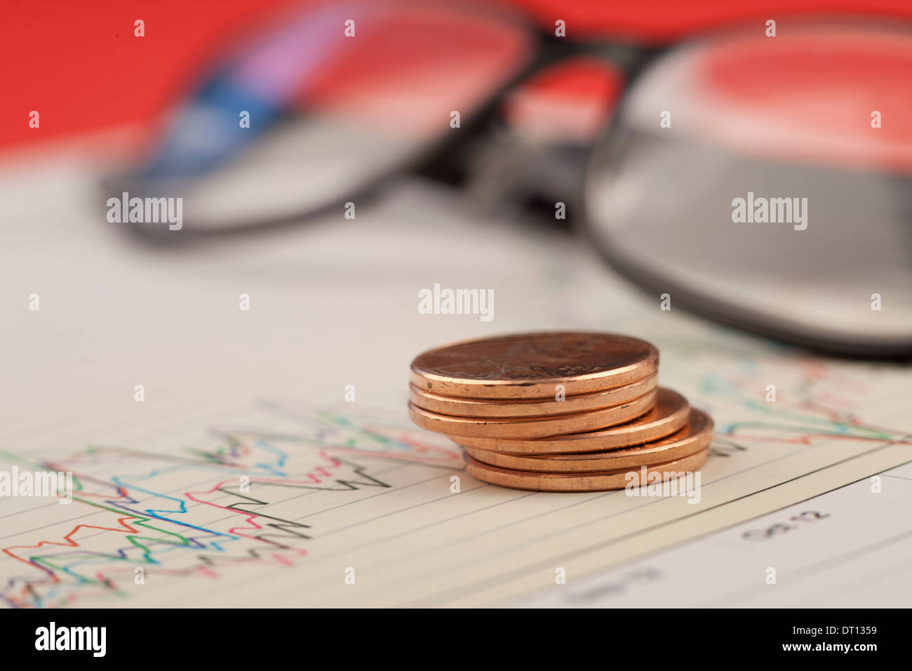 Pile of pennies on graph. - Stock Image